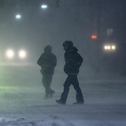 Pedestrians walking across E. Main St. during a storm  Friday, Jan, 22, 2016 in Newark.<br /> <br /> A massive blizzard dumps snow in Newark, and eastern United States on Friday, with mass flight cancellations, five states declaring states of emergency.