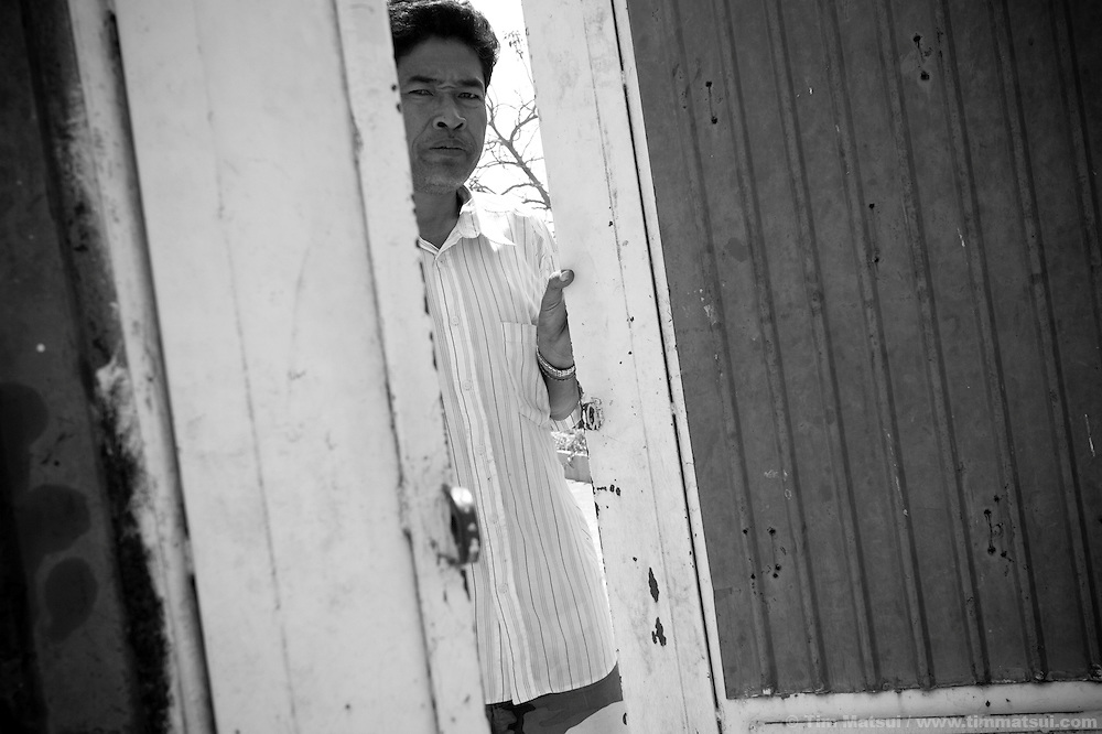 """At the gates of Tom Dy, a residential facility run by the non governmental organization """"Acting for Women in Distressing Situations"""" (AFESIP) on the outskirts of Phnom Penh. Tom Dy offers housing, education, training, and counseling. Founded by Somaly Mam, who herself was once a prostitute and victim of trafficking and domestic abuse, AFESIP has three facilities in Cambodia and works with other NGO's to provide long term care for the women."""