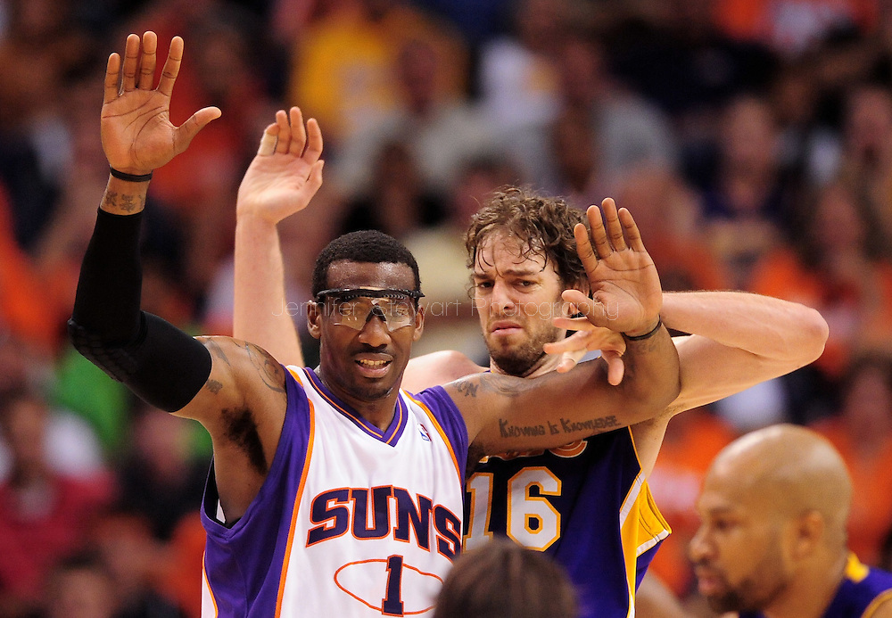 May 25, 2010; Phoenix, AZ, USA; Phoenix Suns forward Amare Stoudemire (1) and Los Angeles Lakers forward Pau Gasol (16) battle for positioning during the second half in game four of the western conference finals in the 2010 NBA Playoffs at US Airways Center.  The Suns defeated the Lakers 115 - 106.  Mandatory Credit: Jennifer Stewart-US PRESSWIRE