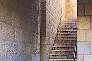 A narrow covered stone stairway in the Jewish Quarter of the Old City of Jerusalem. WATERMARKS WILL NOT APPEAR ON PRINTS OR LICENSED IMAGES.