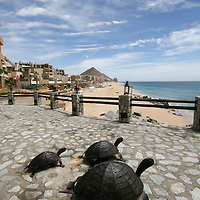 Iron turtles as an exterior decoration of El Farallon, Cliffside seafood grill restaurant at Capella Pedregal Hotel & Resort in Cabo San Lucas, Baja California Sur, Mexico. The turtles welcome the visitor upon entrance, and are a very common object found throughout the resort. In the background you can see the land of Baja California Peninsula, and a popular landmark Land's End.
