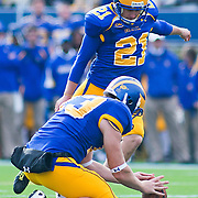 Delaware Kicker (#21) Mike Perry attempting the extra point in the second quarter. No.1 Delaware loses to No. 15 Villanova 28-21 on a brisk Saturday afternoon at Delaware stadium in Newark Delaware...Delaware will have to wait until Sunday 11/21/10 to receive a NCAA Tournament playoff berth,