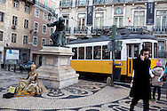 Lisbon's nº28 yellow tram at Chiado square, on his way through the central, most historic region of the city.