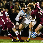 11/10/12 - Waltham, Mass.  Tufts midfielder Maxime Hoppenot, A15, fights for possession of the ball during round one of the NCAA Division III men's soccer match against Vassar on Saturday, November 10, 2012 . (Alonso NIchols/Tufts University)