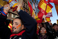 Thousands of people march in Barcelona against the Independence's Call of the Catalan Government. The strike has been organized by the PP, Ciutadans and UPD Political Partys. The strikers don't want the indepenpendence of Catalonia. They feel spanish and catalan.Location: Via Laietana Street
