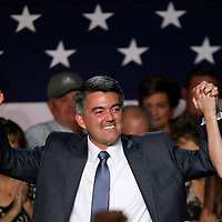 Republican Cory Gardner raises arms with his wife Jamie (R) and daughter Alyson (L) after winning the U.S. Senate race in Colorado in the U.S. midterm elections in Denver, Colorado, November 4, 2014.  REUTERS/Rick Wilking (UNITED STATES)