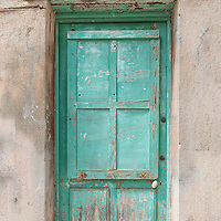 Square green door in Menton, France