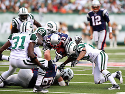 Sept 19, 2011; East Rutherford, NJ, USA; New York Jets cornerback Kyle Wilson (20) tackles New England Patriots running back Kevin Faulk (33) during the 1st half at the New Meadowlands Stadium.