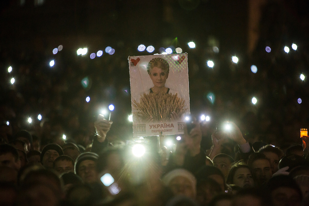 KIEV, UKRAINE - FEBRUARY 22: A poster of former Prime Minister Yulia Tymoshenko is held up in the crowd on Independence Square before her address to anti-government protesters gathered there on February 22, 2014 in Kiev, Ukraine. The leader of the 2004 Orange Revolution against current embattled President Viktor Yanukovych traveled to Kiev to address the crowd immediately after being released from prison on what many claim were politically motivated charges. (Photo by Brendan Hoffman/Getty Images) *** Local Caption ***