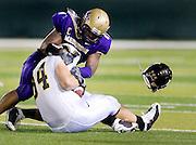 JMU linebacker D.J. Brandon knocks the helmet off of Appalachian State's Ben Jorden during second quarter action at Bridgeforth Stadium in Harrisonburg Saturday night. . JMU upset the number 1 ranked Mountaineers 35-32.
