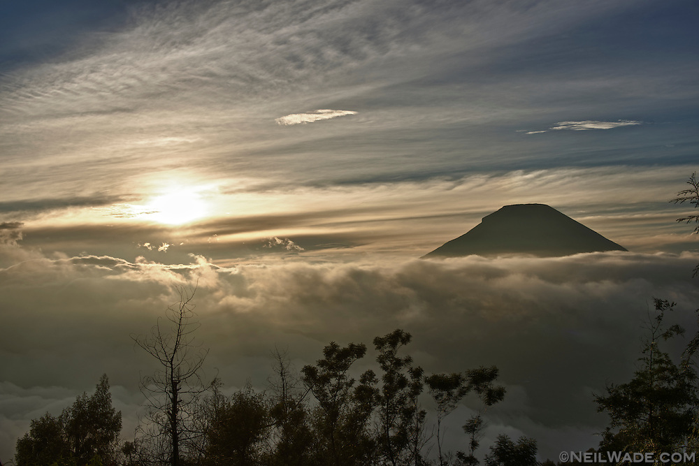 Sunrise over Mount Sundoro, as seen from Dieng, Indonesia.