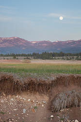 """Full Moon Over Prosser 3""- Photograph of a full moon rising over the mountains at a very low Prosser Reservoir near Truckee, California."