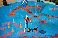 Julia Szymanski, 6 of Ridgewood, NJ plays in the fountains of the pirate themed playground of the Children's Center at the Wequassett Resort and Golf Club in Chatham, Massachusetts on July 12, 2012.   The upscale resort has a number amenities and programs geared towards children including a play center with a pirate themed playground, scavenger hunts, bonfires, and cooking classes. CREDIT: Matthew Healey for The Wall Street Journal.       .HOTELKIDS - Wequassett