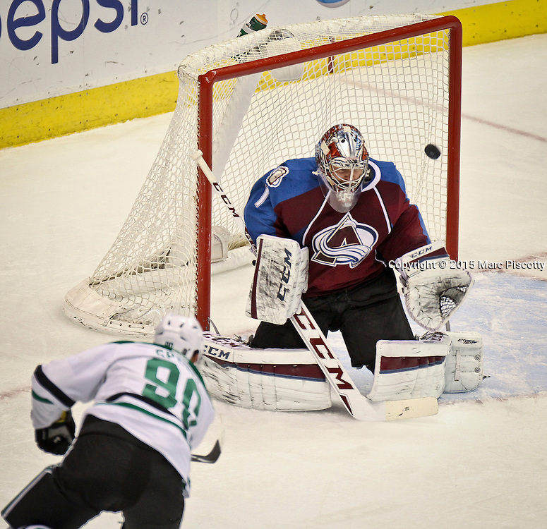 SHOT 1/10/15 2:10:07 PM - Colorado Avalanche goalie Semyon Varlamov #1 stops a shot by the Dallas Stars' Jason Spezza #90 during their regular season game at the Pepsi Center in Denver, Co. Colorado won the game 4-3.  (Photo by Marc Piscotty / © 2015)