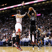 29 January 2012: Miami Heat power forward Udonis Haslem (40) takes a jumpshot over Chicago Bulls power forward Carlos Boozer (5) during the Miami Heat 97-93 victory over the Chicago Bulls at the AmericanAirlines Arena, Miami, Florida, USA.