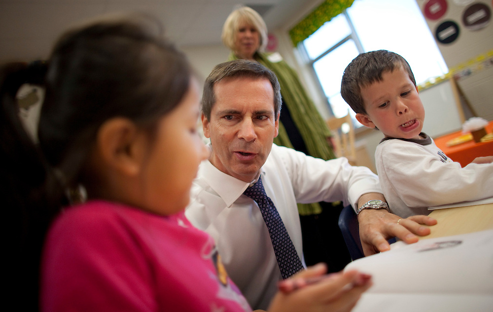London, Ontario ---10-10-08---  Premier Dalton McGuinty talks with Amaris Peng, left, and Jackson Williams in a full day kindergarten class during his visit to Stoney Creek Public School in London, Ontario, October 8, 2010.<br /> GEOFF ROBINS The Globe and Mail