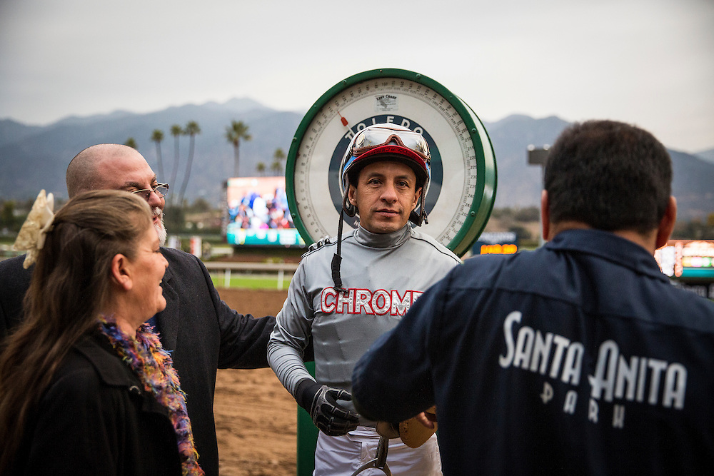 January 09, 2016: Jockey, Victor Espinoza celebrates a victory in the Sham Stakes  aboard California Chrome at Santa Anita Park, Arcadia CA. Evers/ESW/CSM