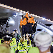 Bertrand Piccard greets André Borschberg after a successful landing in Muscat, Oman