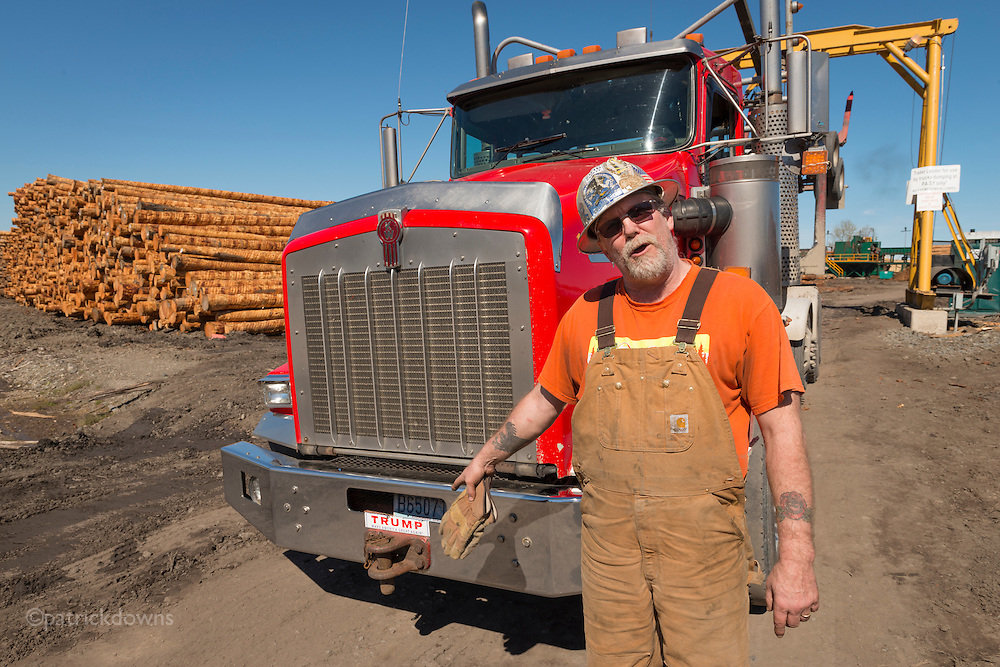 A log truck driver points to his Trump bumper sticker. He said he wasn't excited about voting for him, but it was better than the other choice.  That was Election 2016 for many people, it seems—voting for the person you disliked less.