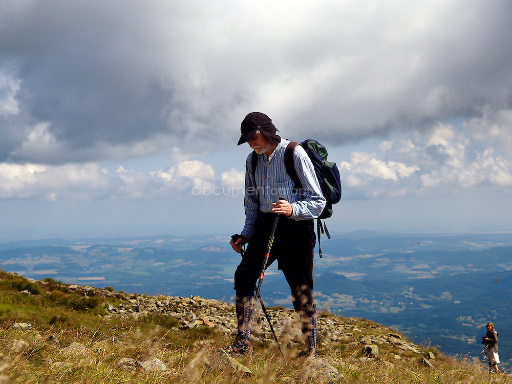 A man walking near the top of of Snezka, Krkonose, Czech Republic.