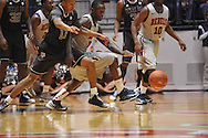 Ole Miss' Murphy Holloway (31) and Texas A&M's J'Mychal Reese (11) go for the ball in Oxford, Miss. on Wednesday, February 27, 2013. (AP Photo/Oxford Eagle, Bruce Newman)