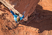 """Climber and podcaster Chris Kalous climbing his route (equipped by Sam Lightner) """"The Ivory Tower """"(13b) on Castleton Tower in Southern Utah."""