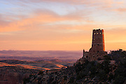 Sunrise over the Painted Desert and the Watchtower at Desert View. South Rim of Grand Canyon National Park in Arizona.