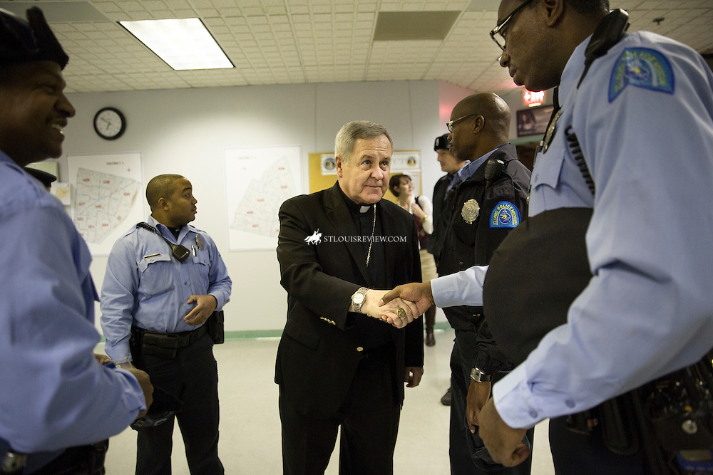 Lisa Johnston | lisajohnston@archstl.org | Twitter: @aeternusphoto Archbishop Robert J. Carlson visited with the St. Louis City police Centra Patrol Division on Nov. 24 to meet and pray with them before the announcement of the St. Louis County Grand Jury decision whether to indict police officer Darren Wilson in the shooting death of Michael Brown.