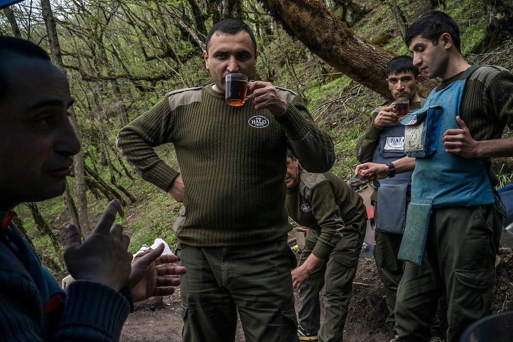 HAGOB KAMARI, NAGORNO-KARABAKH - APRIL 20: Workers with the land mine clearance charity HALO Trust take a tea break on April 20, 2015 in Hagob Kamari, Nagorno-Karabakh. Since signing a ceasefire in a war with Azerbaijan in 1994, Nagorno-Karabakh, officially part of Azerbaijan, has functioned as a self-declared independent republic and de facto part of Armenia, with hostilities along the line of contact between Nagorno-Karabakh and Azerbaijan occasionally flaring up and causing casualties. (Photo by Brendan Hoffman/Getty Images) *** Local Caption ***