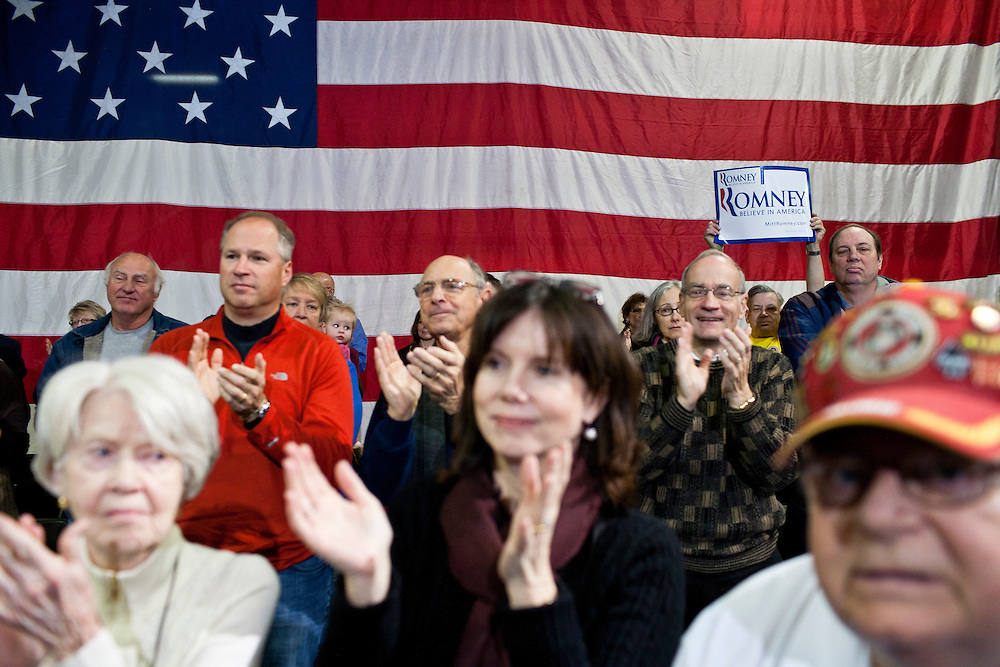 The audience applauds as Republican presidential candidate Mitt Romney arrives at at a town hall meeting at the Diamond V South Plant on Friday, December 9, 2011 in Cedar Rapids, IA.