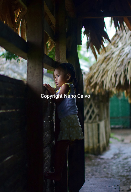 Portrait of a Bribri young girl (Adriana) inside a cottage. <br />