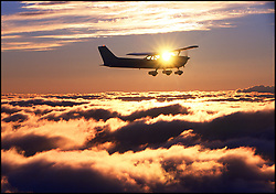 Cessna 172 over clouds
