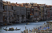 """SHOT 3/7/2006 - Venice is one of Italy's most beautiful and romantic cities, built on the water in a lagoon. Venice has many magnificent churches and palaces, lively squares, and interesting shops. It is one of the biggest travel destinations in Italy. Venice is also home of one of the biggest Carnevale celebrations in Italy. The 150 canals of Venice are its streets - roads for land passenger vehicles are nonexistent. Everyone must travel by foot or boat, tourists and locals alike. The Grand Canal (Italian: Canal Grande) is the most important canals in Venice, Italy. It forms one of the major water-traffic corridors in the city. Public transportation is provided by the water bus and by private water taxis. The GRand Canal of Venice runs through most of the city, it """"starts"""" from the lagoon near the train station, makes a large S-shape through the central districts, the """"sestiere"""" of Venice, and ends at the Basilica di Santa Maria della Salute, near Piazza San Marco (Saint Mark's Square), with an average depth of five meters. Its banks are lined with some of the most beautiful buildings of the city, amongst the many structures are Ca' Rezzonico, Ca d'Oro, Ca' Foscari, Palazzo Venier dei Leoni, housing the Peggy Guggenheim Collection, as well as both Pallazi from the two branches of the noble Barbaro family. Some of the churches along the canal include Basilica di Santa Maria della Salute and Il Redentore..(MARC PISCOTTY/ © 2006)"""