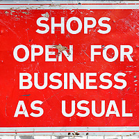 Construction sign - shops open for business as usual