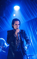 Frontman Nick Cave, of Nick Cave and the Bad Seeds, under a spotlight on stage tonight at The Barrowlands, Glasgow, Scotland.<br /> &copy;Michael Schofield.