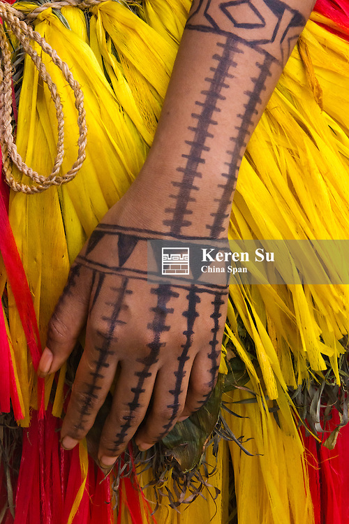 Yapese girl in traditional clothing with tattoo on the hand at Yap Day Festival, Yap Island, Federated States of Micronesia