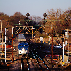 Amtrak's Southwest Chief is flying west under the signals at Buda, IL on the BNSF.