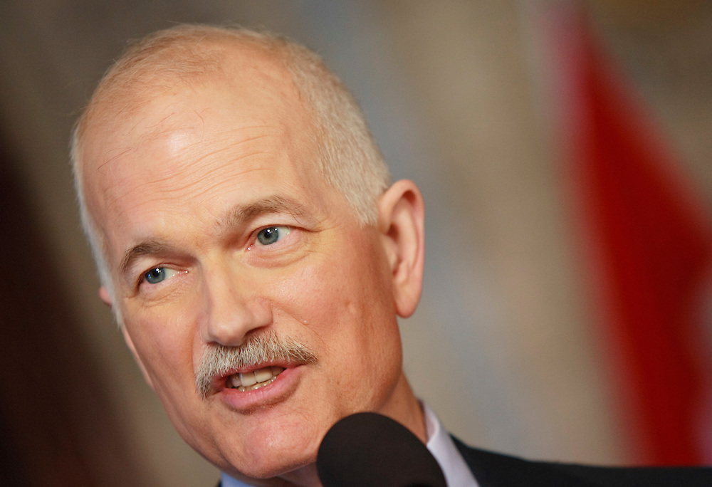 NDP leader Jack Layton speaks at a press conference in the foyer of the House of Commons in Ottawa, Canada following the fall of the Conservative government in a non confidence vote March 25, 2011. Canadians will be heading to the polls in May.<br /> AFP/GEOFF ROBINS/STR