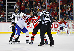 Jan 2, 2009; Newark, NJ, USA; Montreal Canadiens right wing Tom Kostopoulos (6) and New Jersey Devils right wing David Clarkson (23) fight during the first period at the Prudential Center.