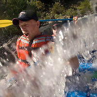 SATURDAY JULY 8, 2006 - LOTUS, CA Glen Finch, left, and Bruce MacDonald get hit by a wave at the Healing Waters weekend retreat, a non profit whose mission is to empower, inspire and enrich the lives of people challenging HIV/AIDS through wilderness adventures, on Saturday, July 8, 2006 on the South Fork of the American River in Calif.