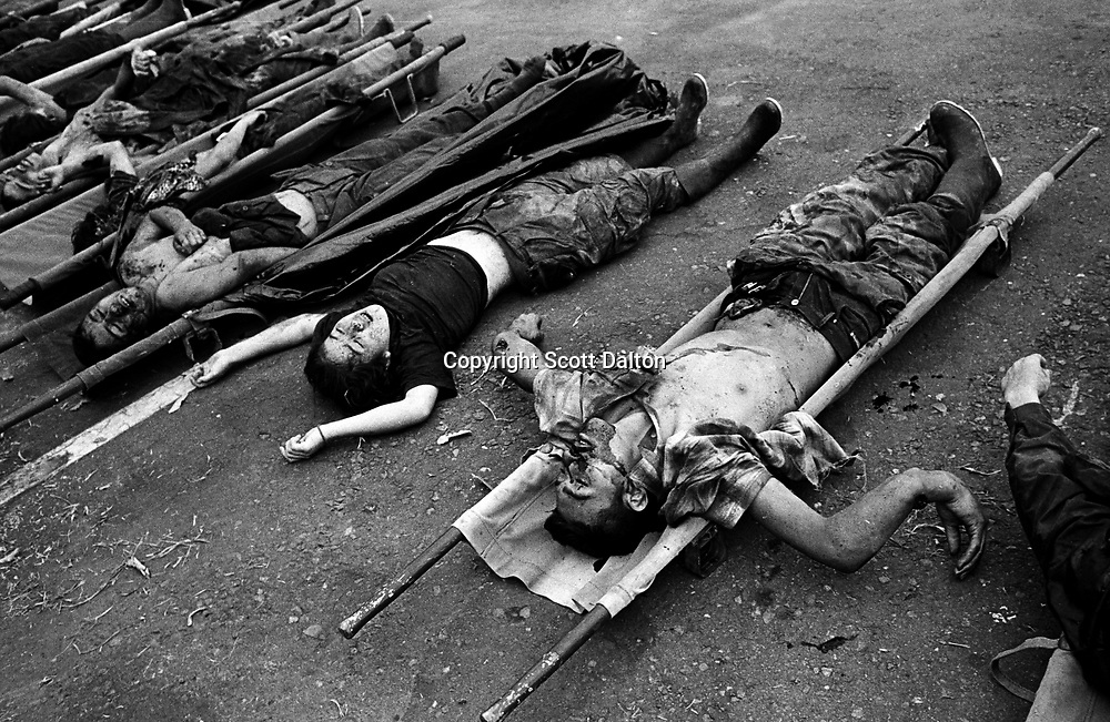 Dead bodies of FARC rebels killed in combat with government troops are laid out at a military base in Bucaramanga. (Photo/Scott Dalton)