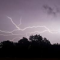 Pine Island, New York - Lightning streaks across the sky during a summer thunderstorm on Aug. 21, 2014.