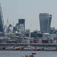 The City of London with the Cheesegrater on the left and the Walkie-Talkie on the right.