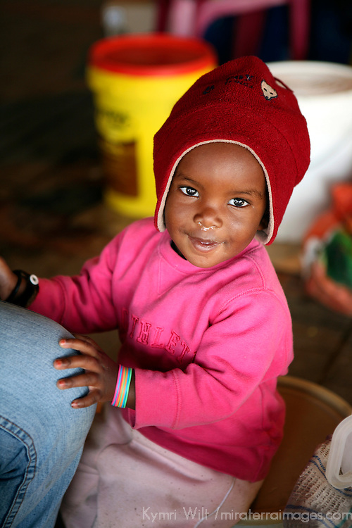 Africa, Namibia, Windhoek. A young Namibian baby at the Katutura street market.