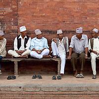 Men on bench. Kathmandu, Nepal