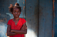 Girl folding her arms near Port Salut in the Tiburon Peninsula, Haiti