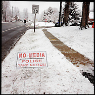 NEWTOWN, CT-10 December 2013- A sign along the street in front of the St. Rose of Lima Catholic Church, where funerals for eight of the 20 children killed were held a year ago, makes it clear they do not wish for any media attention on the anniversary of the shooting. (Photo by Robert Falcetti)