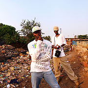 Double K, Kool King (front) and King Osu (back) by the Crocodile River in Kroo Bay, Freetown, Sierra Leone.