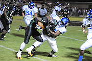 Water Valley's Quinterrio Bailey (24) makes a tackle vs. Mooreville in Mooreville, Miss. on Friday, September 30, 2011. Water Valley won 21-20 in overtime.