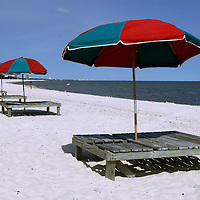 Vacant rental beach chairs and umbrelllas wait for customers in  Gulfport, Mississippi May 9, 2010.  News of the BP oil spill is killing business and tourism on the coast with one surfside rental company reporting business off 70 percent. REUTERS/Rick Wilking (UNITED STATES)